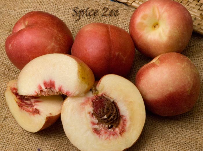 Spice Zee_Nectaplum. Delicious cross between a plum and nectarine. Great flavor. Beautiful pink blooms in the spring. 200 chill hours. Zones 6-10.